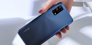 realme 7 5g phone in hand